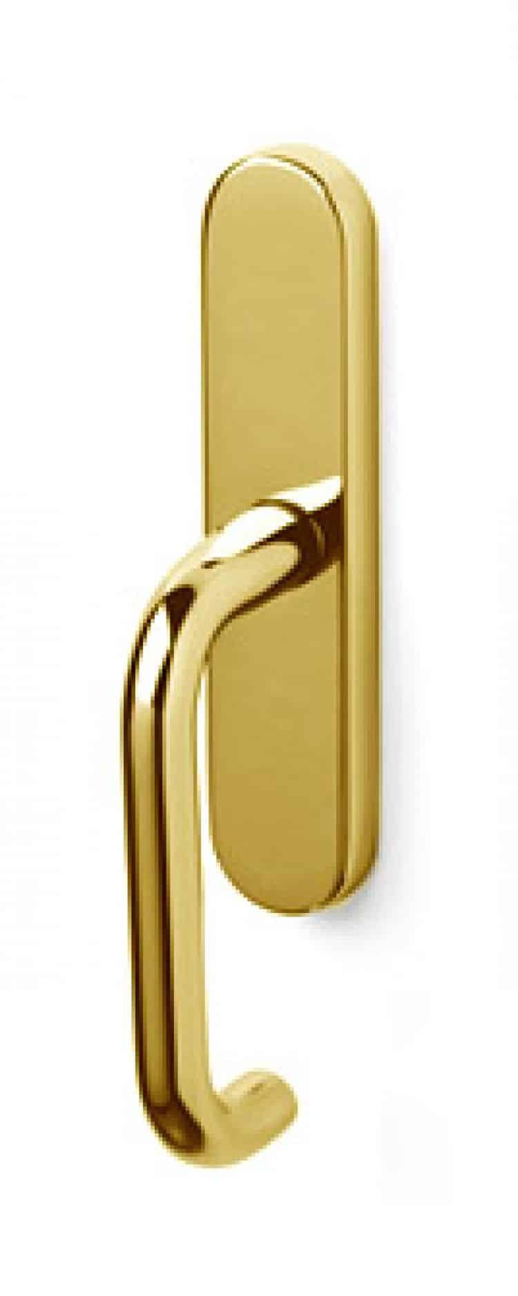 Maniglie di design per porte e finestre olivari for Maniglie porte oro